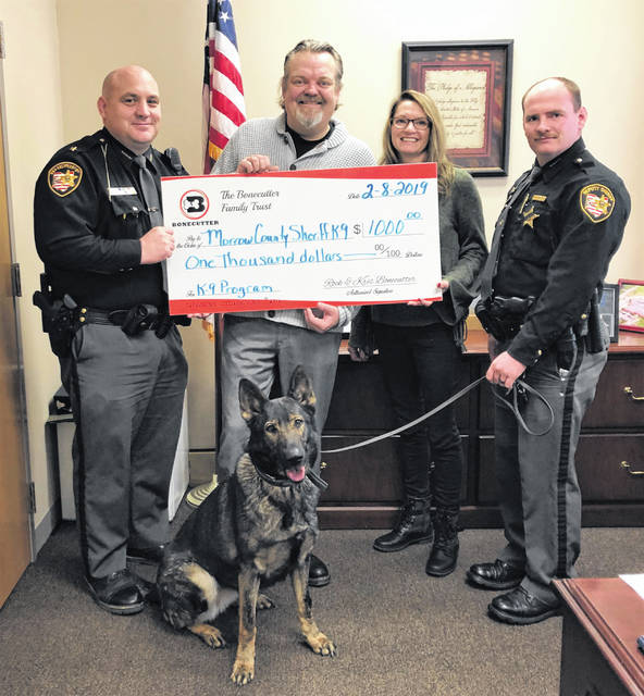 The Morrow County Sheriff's Office K-9 program recently received a $1,000 donation from the Bonecutter Family aspart of the Bonecutters monthly Charitable Giving Campaign. Present to accept the donation were Morrow County Sheriff John Hinton, K-9 Handler Deputy James Coulter and K-9 Officer Stormy, with Rockwell and Krista Bonecutter.