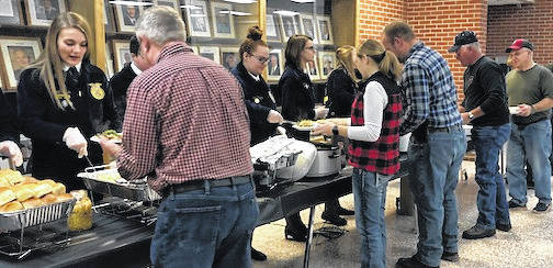 Pictured are Cardington FFA members serving dinner to area farmers