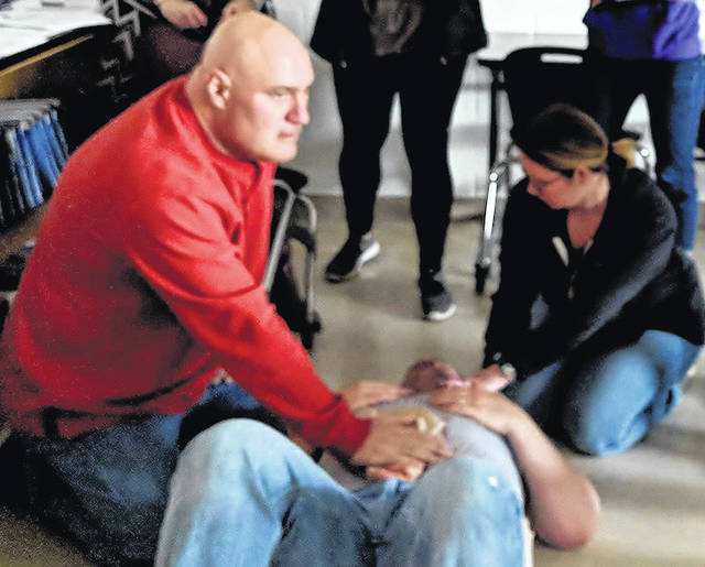 A wounded person is dragged into a classroom and checked for injuries as part of the active shooter training at Mount Gilead Schools.