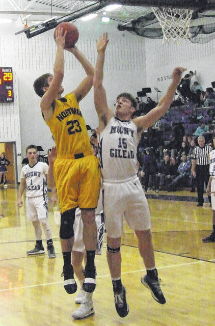 Northmor's Blake Miller tries to put the ball in from short range in his team's overtime win at Mount Gilead Friday.