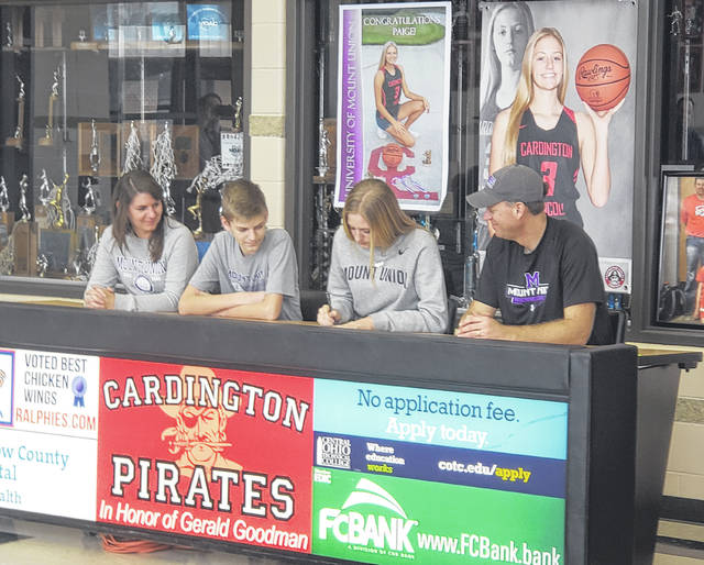 Cardington's Paige Clinger signed Wednesday to play basketball at the University of Mount Union. Pictured above are (l-r), mother Molly, brother Ryan, Clinger and father Matt.