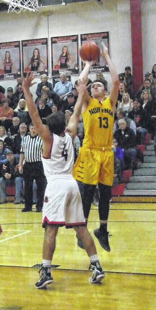 Northmor's Hunter Mariotti goes up for a shot against Pleasant in Monday night's sectional basketball contest.
