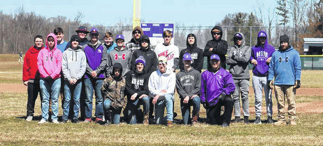 The Mount Gilead baseball team spent part of Saturday working to prepare local youth baseball diamonds for the season.