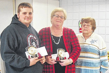 Trent Crum and Angie Bush, recipients of the Community Service Award presented by the Chester Arbor of the Gleaner Fraternal Insurance Society, presented by Rita Barton, president of the Society, at right.