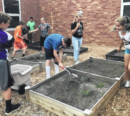 Mount Gilead Middle School students work on several tasks in their Outdoor Classroom. The Outdoor Classroom was made possible with donations.