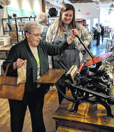 Shirley Furr tries her hand at making a card at the Igloo Letterpress in Worthington.