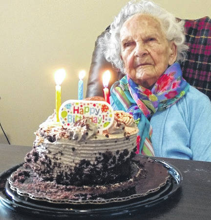 Pictured is Martha Porter, celebrating 102 years on March 7. She is shown with the cake provided by her family.