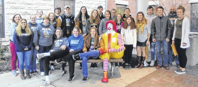 Northmor JOG and Youth Safety Council went to the Ronald McDonald House. Students clean windows.