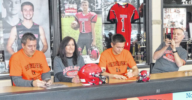 Attending, from left, are Thomas Radcliffe, Denise Radcliffe, Cardington senior Branden Steckel and Bradley Steckel during Branden's commitment to attend and play football at Heidelberg University.