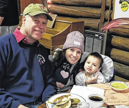 Dining at the Lutheran Memorial Camp Maple Syrup Festival were Columbus residents Jerry Brenik and his daughter Kristi Kline who is holding her five-month-old daughter. Accompanying her was Lucas, age 2.
