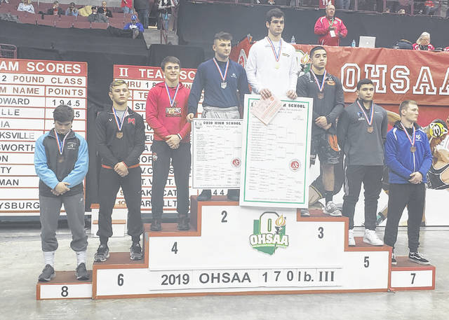 Northmor's Conor Becker stands at the top of the podium Saturday night after winning the Division III 170-pound weight class at the state wrestling meet.