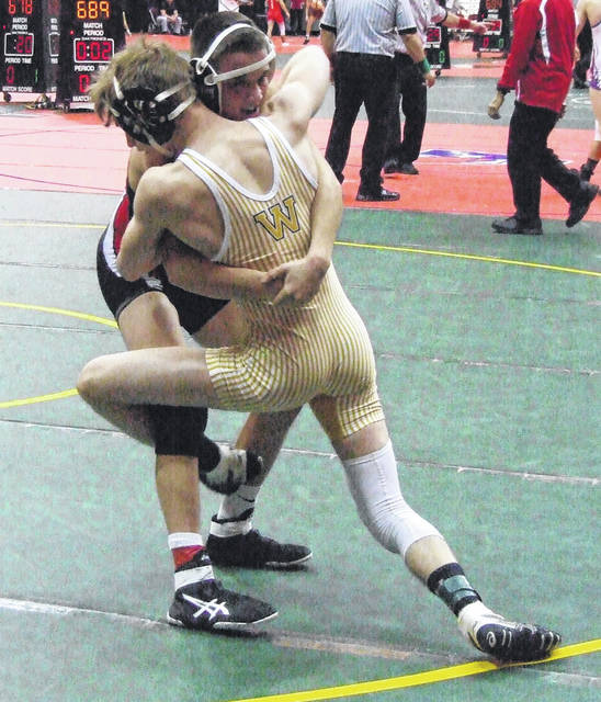 Cardington's Draven Hubley grapples for control against Seth Unkefer of Apple Creek Waynedale in the state wrestling meet on Friday.