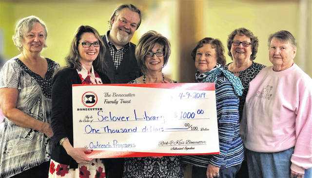 Selover Library Director Suzi Lyle and board members Andi Vuckovich, Anna Mahan, Joyce Ray and Pat Ebersole were on hand to accept the check from Rockwell and Krista Bonecutter.