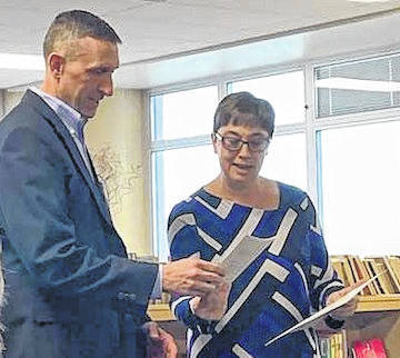 Wednesday night at the Highland School Board meeting, school board member Eric Thacker was recognized by Kim Miller-Smith from the Ohio School Boards Association for his commitment and service to the Highland Local School District for the past 10 years.