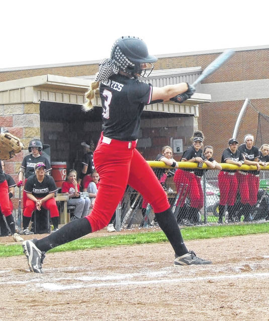 Cardington's Paige Clinger takes a cut at a Highland pitch in her team's 8-5 softball win Wednesday.