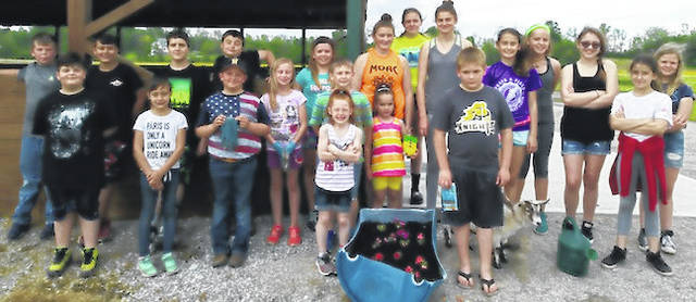 The club placed flags at Glendale Cemetery in Cardington on May 24 for Memorial Day. Members also placed flowers in some of the flower barrels at the Morrow County Fairgrounds.
