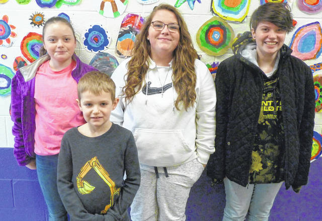 The art work of these four Mount Gilead art students was displayed at the Rhodes Tower recently. Shown are, back from left: Jayden Andrews, Lilyth Edgerly and Victoria Salvito and Mason Kirkpatrick, front.