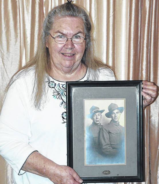 Ellen Burson McMurray holds the photo of her great uncles who served in World War I. Their service was described during the recent Morrow County Historical Society dinner. William Roy Corwin, left, who was wounded in France and Fred B. Corwin, who died in France as a result of his wounds.