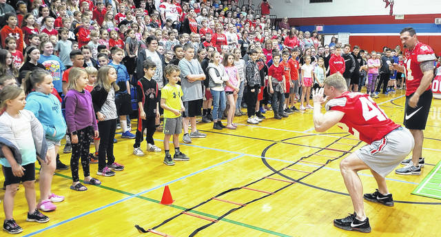 Former Ohio State University and NFL linebackers Bobby Carpenter and Anthony Schlegel, UnitedHealthcare leaders and school officials surprised Highland Elementary students with the announcement at a pep rally Thursday morning.