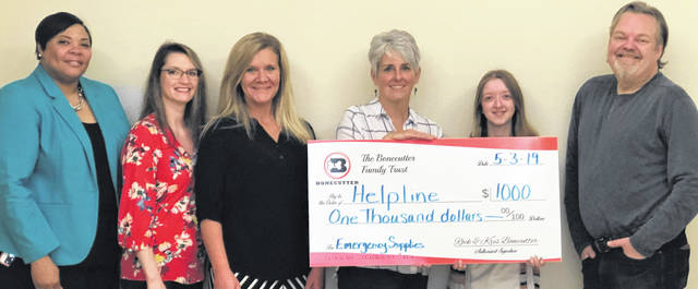 At the check presentation are, from left, Tamika Vinson-Reid HelpLIne Marketing and Development Director, Krista Bonecutter, Coriena Anderson HelpLIne administrative assistant, Sue Hanson Director HelpLine, Alyson Lanning HelpLine lead hotline specialist, and Rockwell Bonecutter.