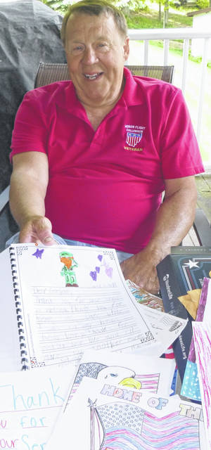 Highland Local Schools students wrote letters thanking Leon Holtrey for his service in the Vietnam War prior to him taking an Honor Flight April 27.