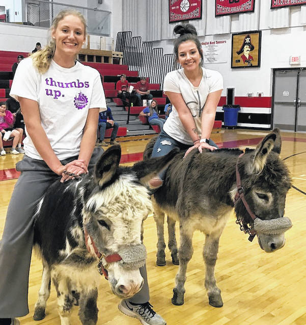 Cardington FFA members Paige Clinger, left, and Maci Morgan on donkeys during the annual FFA-sponsored donkey basketball games.
