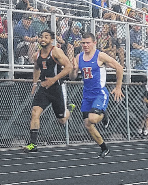 Highland's Brock Veley (r) advanced to the regional finals in the 100-meter dash, as well as in the 400-meter relay with Jack Weaver, Landyn Albanese and Chase Carpenter.