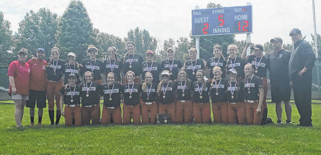 The Cardington softball team shows off the fourth district title trophy they've earned in a four-year span after dispatching Utica by a 12-2 margin on Saturday.