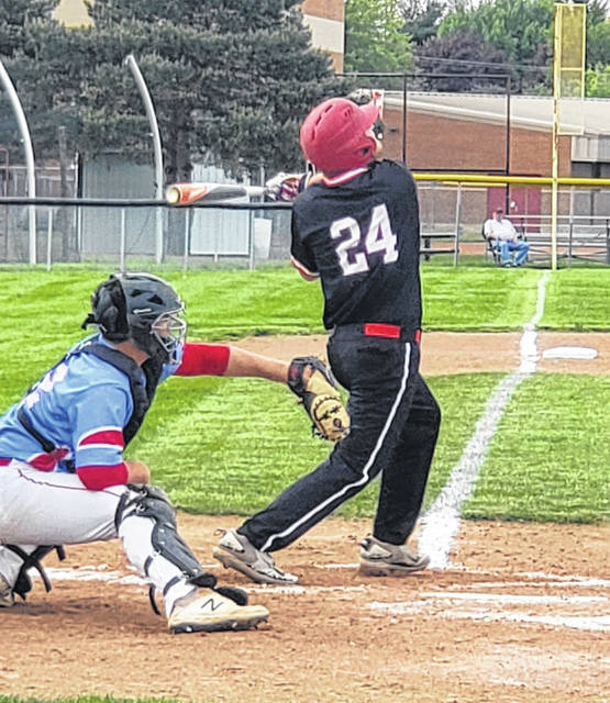 Cardington's Kolton Honeter takes a cut at a Ridgedale pitch in Wednesday's tournament baseball game.