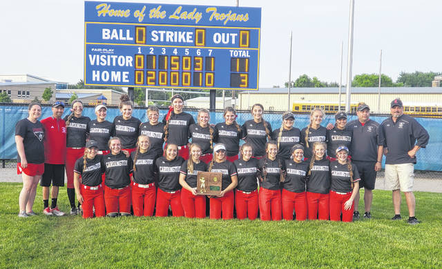 The Cardington softball team is in front of the scoreboard with their trophy after topping Galion 11-3 for a regional title and their third straight trip to the Division III Final Four.