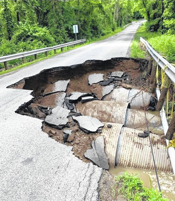A portion of County Road 40 near Candlewood Lake is closed after rains washed away part of the road surface.