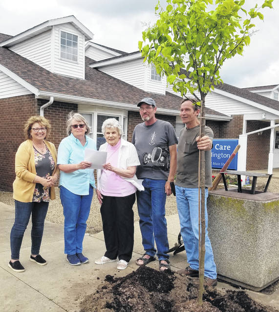To recognize Evelyn Long's decades of service, Cardington dedicated a tree in her honor at the village's recent annual Arbor Day observance. Shown, from left, are Deb Fry, Susie Peyton, Evelyn Long, Kevin Long and Alan Long.