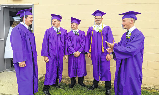 Mount Gilead seniors savor a last moment with classmates. Seniors visit before the commencement program begin.