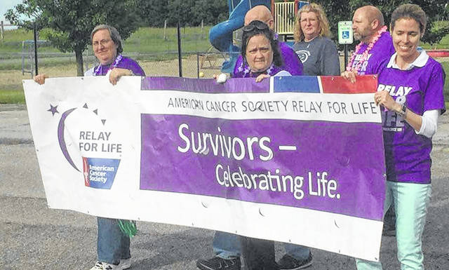 Relay For Life begins with the survivors lap Friday night. • More photos online at morrowcountysentinel.com.
