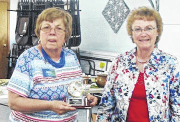 Rita Barton, president of the Chester Arbor of the Gleaners, presents the Community Service Award to Margie Saull for her leadership in planning the Veterans Honor Flight in Marion.