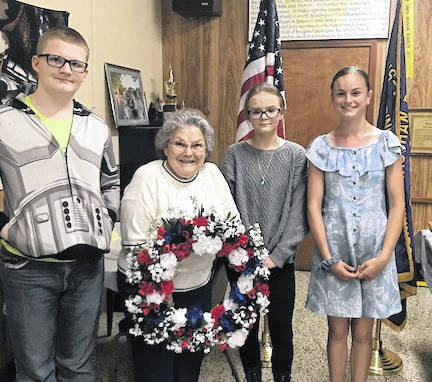 Shown are, from left, Luke Bradford, Shirley Dendinger with a wreath she made to be placed on the Vietnam Memorial in Washington, D.C., Ciara Giamarco and Kennedy Maceyko. The three students are in eighth grade and took Dendinger's wreath to be placed.