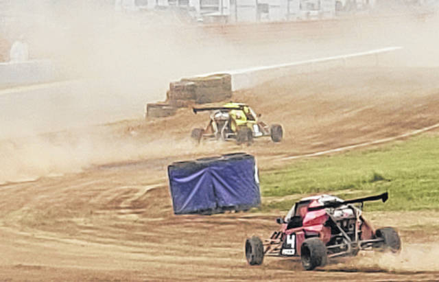 ARX vehicles kick up the dust while navigating the dirt portion of the track for their event at Mid-Ohio Sports Car Course this past weekend.