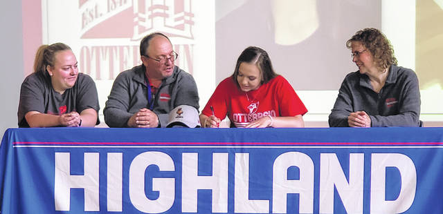 Highland's Bridget Oder (second from right) will follow up her high school volleyball career by moving on to Otterbein to continue in that sport. Sitting with her are (l-r), sister Megan, father Joe and mother Vickie.