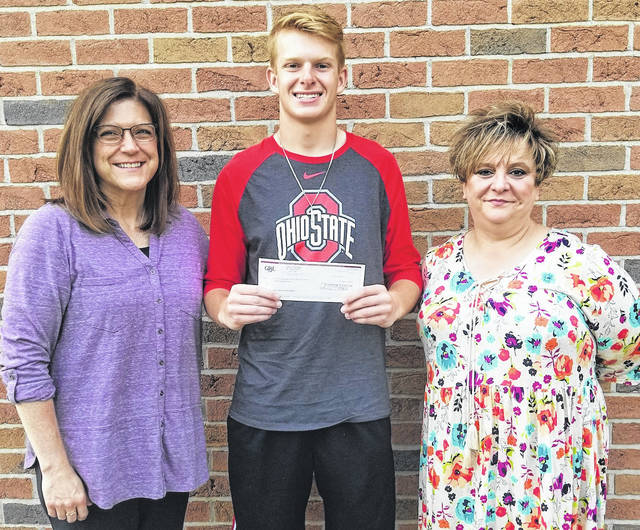 Northmor graduate Chris Bood receives the check for the Jeremy Beck Award from Angie Humberson, left, and Trish Tetras.