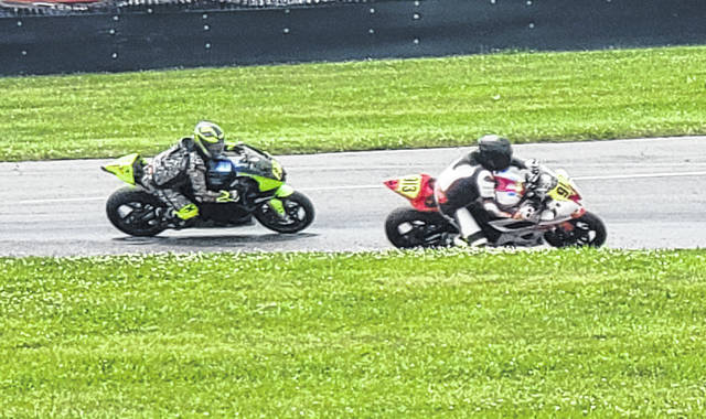 Motorcycles jockey for position on Saturday at Mid-Ohio Sports Car Course during AMA's Vintage Motorcycle Days.