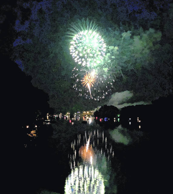 Fireworks at Candlewood Lake on July 4 light up the night sky. Weather across north central Ohio cooperated for most scheduled fireworks displays. More photos online at morrowcountysentinel.com.