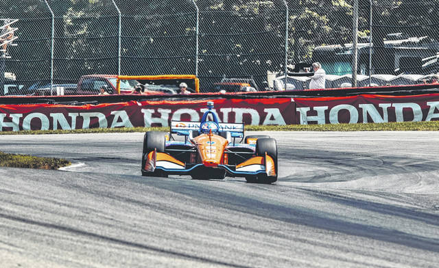 Scott Dixon claimed his sixth win at Mid-Ohio on Sunday when he held off teammate Felix Rosenqvist to take first place in the Honda Indy 200.