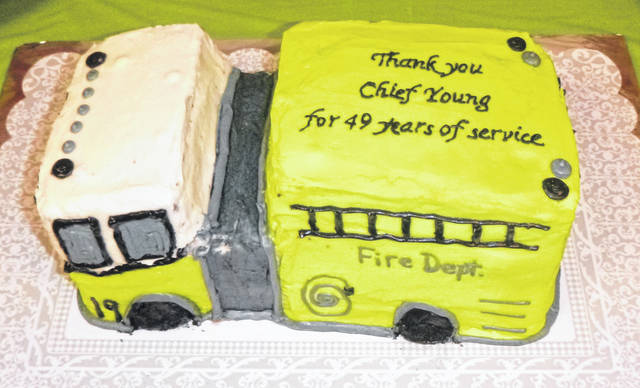 A cake commemorates retiring Fire Chief Greg Young's 49 years of service to Mount Gilead.
