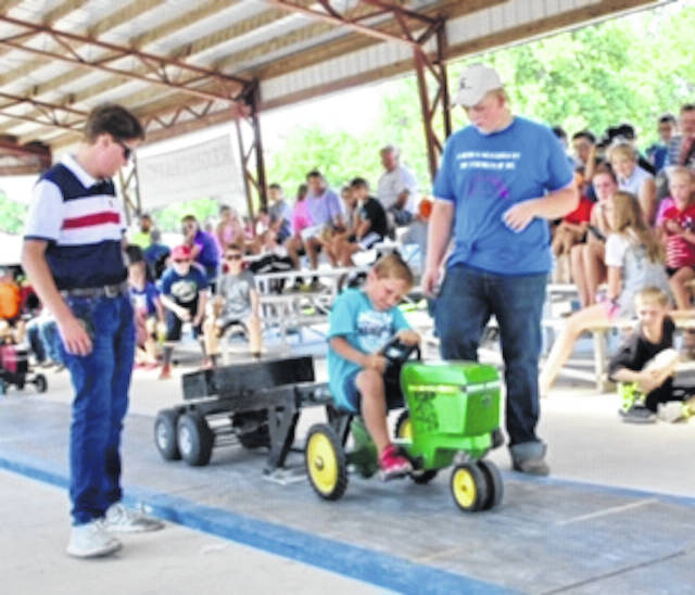 Colton Brandum pedals his way to first place in the Class 2 Pedal Pull during Farm Days.