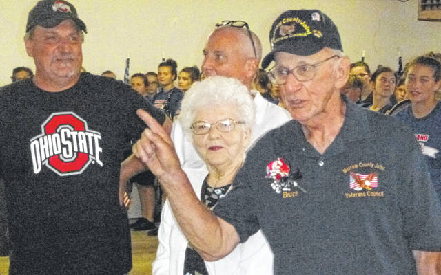 Bruce Fissell received a surprise recognition during the Morrow County Fair's tribute to veterans Tuesday afternoon. He was joined by his wife Belva and sons Steve and Brent.