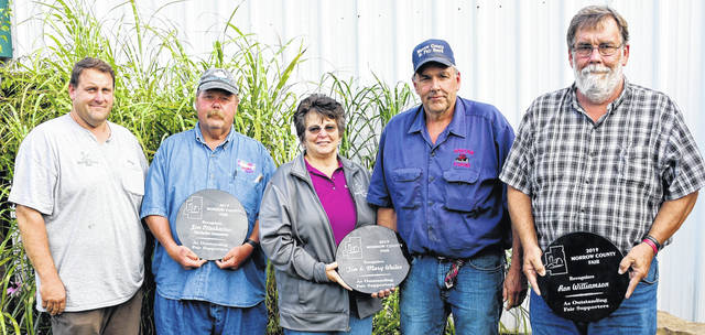 Honored as outstanding Morrow County Fair supporters during the program held Tuesday evening are, from left, Anthony Shaffer, Senior Fair Board president; Jim Otterbacher, owner of Otterbacher Shows; Mary Weiler, secretary-treasurer of the Morrow County Fair Board; Tim Weiler, Senior Fair board member and Ronnie Williams, Senior Fair Board member.