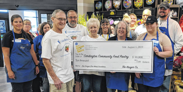 Shown, front from left: Paul Cole, John Lawyer and Cheryl Burket from Cardington Community Food Pantry and Kroger team members Aaron Warkentin and Amanda Thompson. Other team members are Marie Hendrickson, Nicole Kirk, Lee Coleman and Caleb Fissell with Kroger store leader, Jeff Minner.