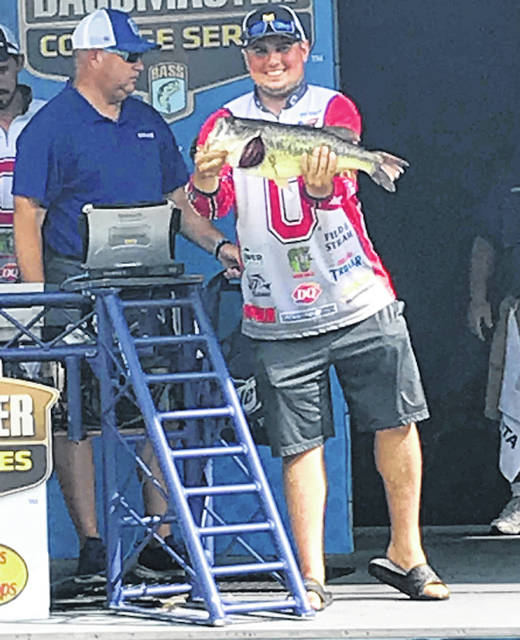 Grant Hack of Mount Gilead displays a fish caught at the college national championship event held in early August in Tennessee.