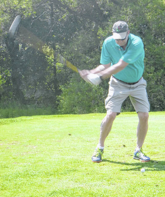 Jamey Laskey tees off on the first hole at Bent Tree in the Kiwanis Club golf outing on Aug. 14.