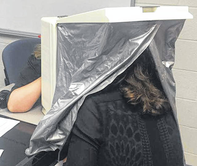 Candace Heer, Extension Educator, Ohio State University Extension-Morrow County, performs a DermaScan after the Morrow County Chamber of Commerce luncheon Aug. 20. Heer spoke about the dangers of the sun and skin cancer and then did an educational DermaScan with several members. The scan can identify sun-damaged skin.